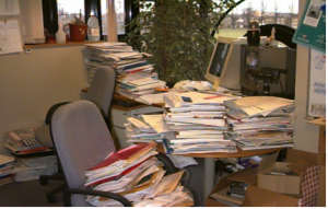 Office and desk full of files and paper